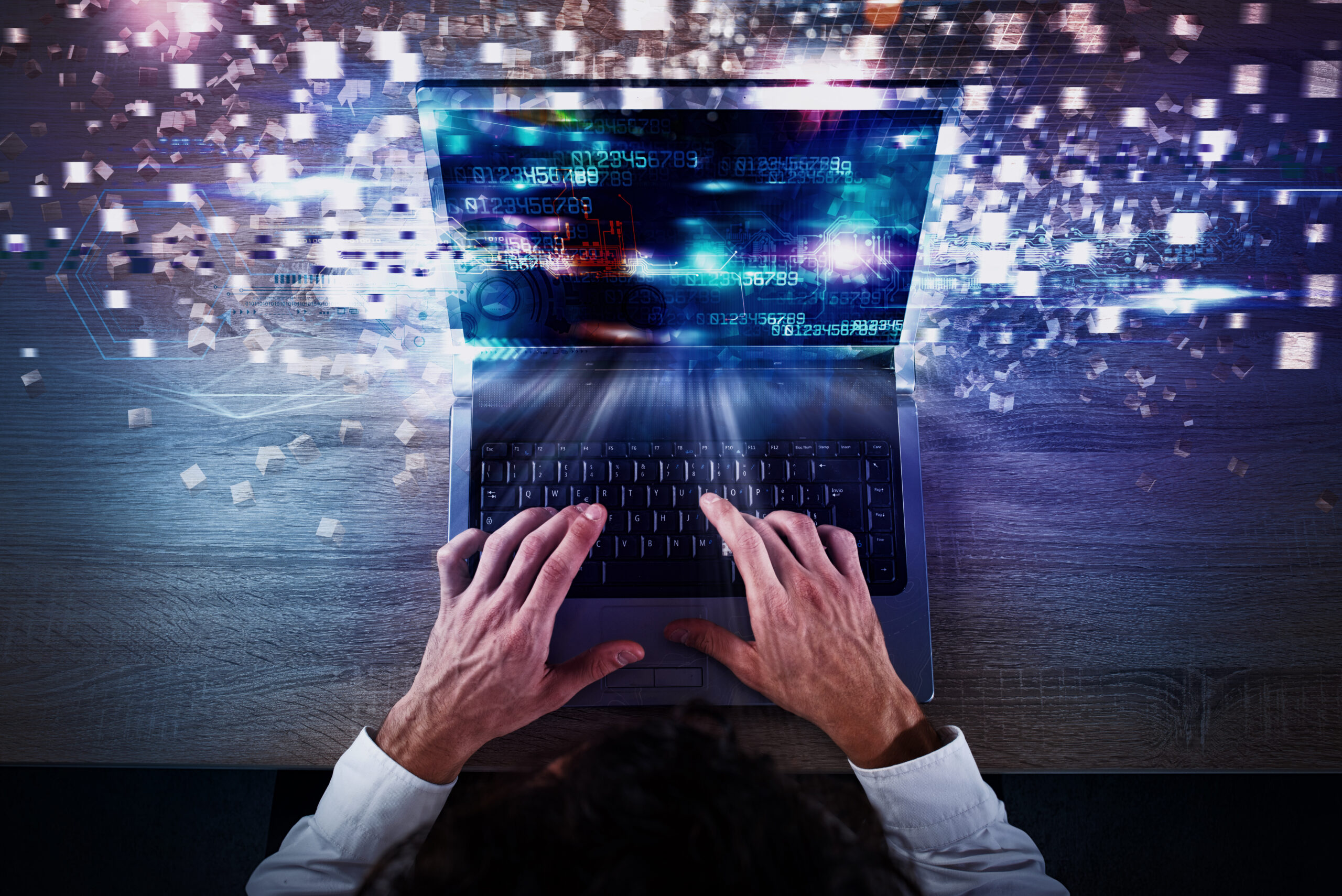 Businessman works with laptop and Futuristic lights on screen. Global internet connection and streaming concept